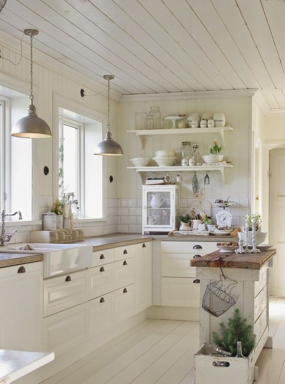 Farmhouse style kitchen with a tiny but useful narrow kitchen island